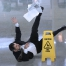 Man slipping on a wet floor.