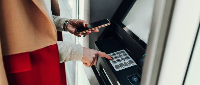 Women cashing out at ATM