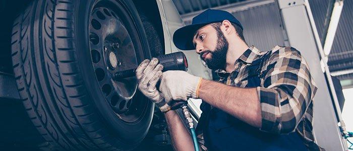 Tire dealer fixing car tire