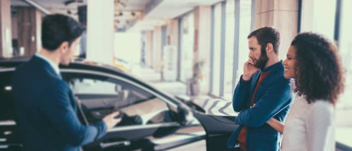 Dealer selling car at dealership