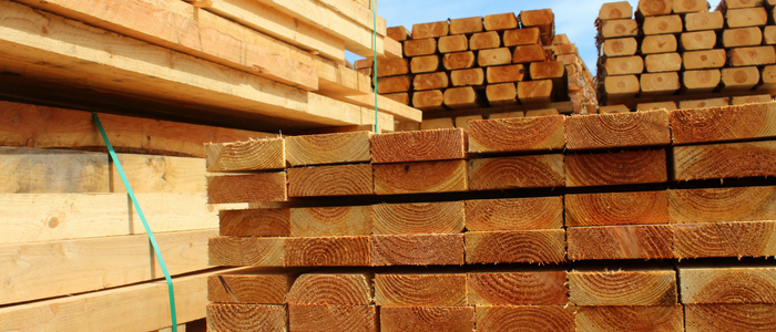 Close up of stacks of lumber on construction site
