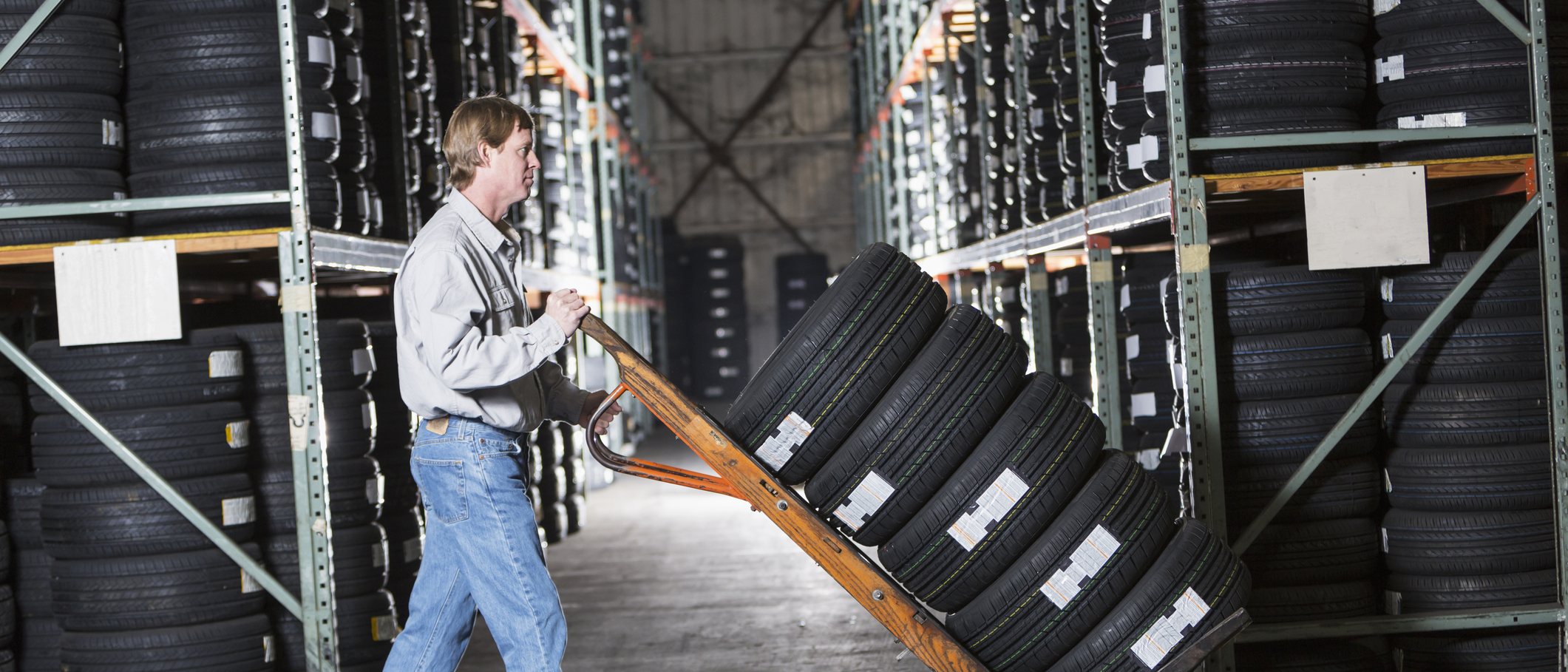 Businesses owner storing tires in warehouse