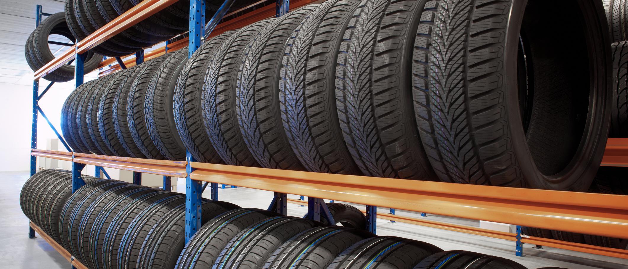 Black tires stored on shelf in warehouse
