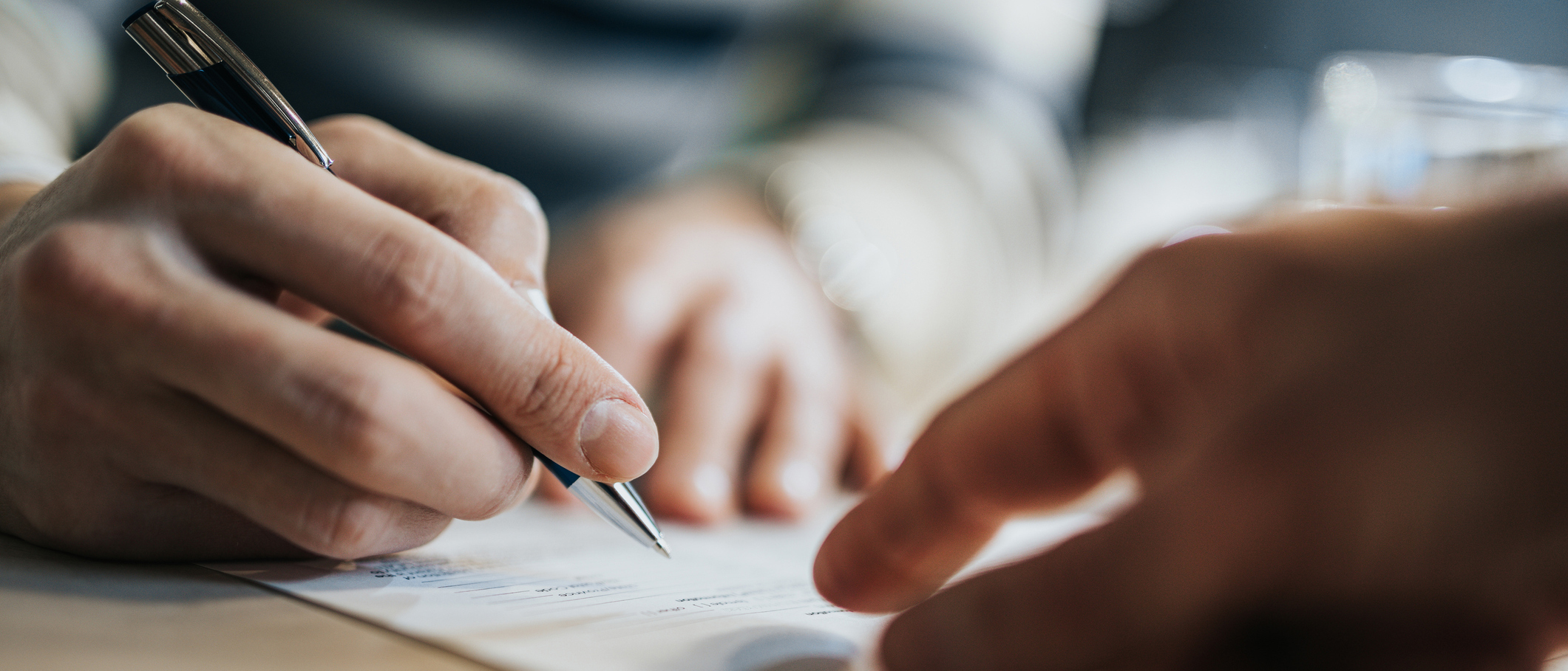 A business owner signing an insurance policy.