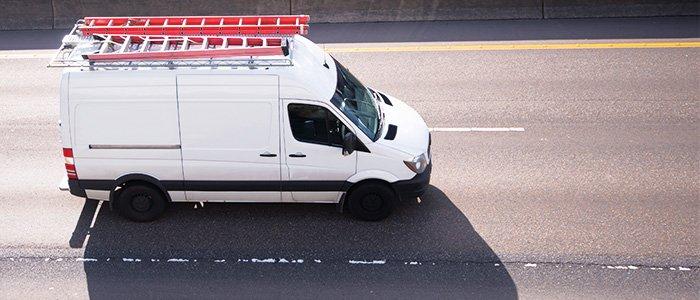commercial cargo van driving on road