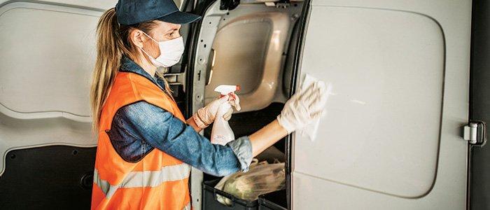 Female driver cleaning van