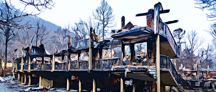 A burned motel after a forest fire